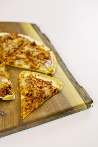 A BBQ Chicken Tortilla Pizza recipe that is perfect for summer entertaining. Made with Dorothy Lynch it's easy to make, quick to cook, and absolutely delicious.