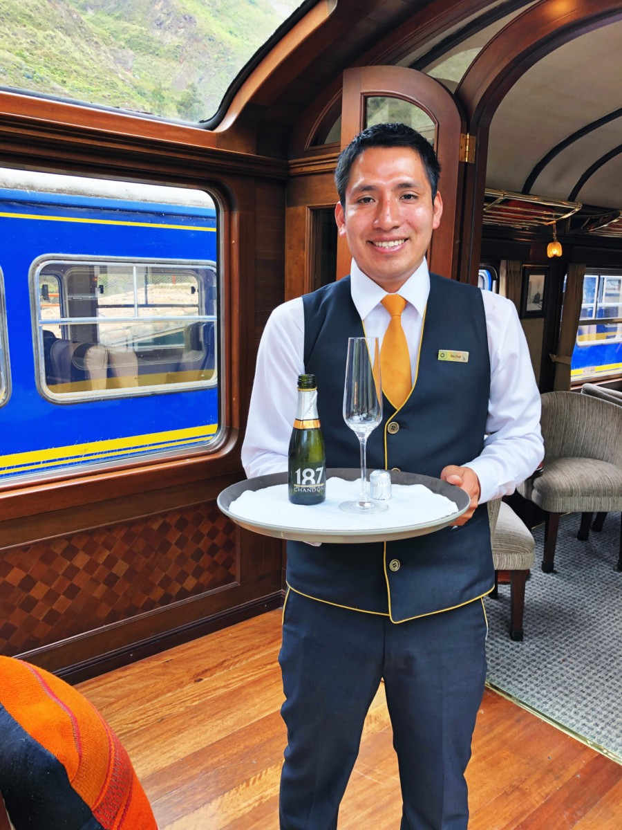 Man holding wine on Sacred Valley Train